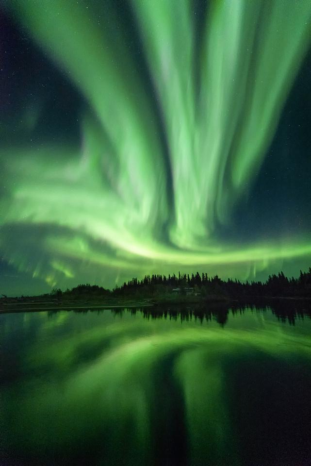 Aurora Borealis screams across the northern skies of Hay River, Northwest Territories