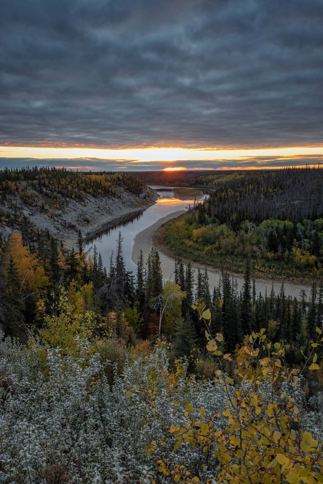 Sunset over the Hay River, NT, as fall colours dominate the scene.